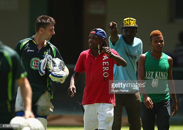 Shaun Marsh of Australia is spoken to by locals wanting match tickets during an Australian nets session at Sabina Park on June 10 2015 in Kingston...