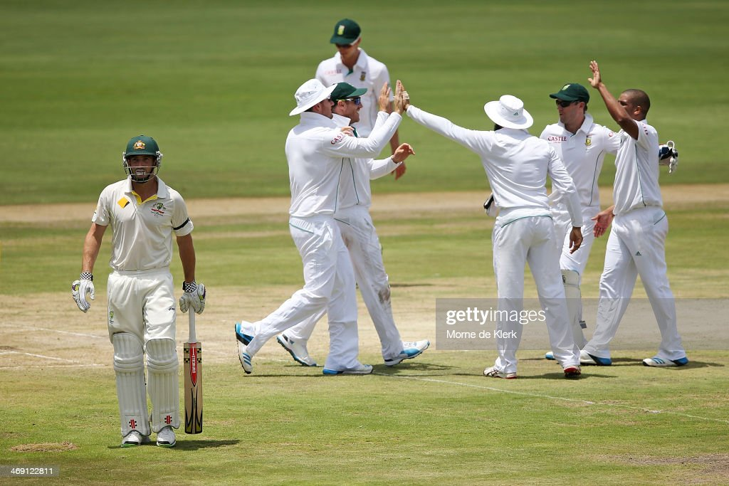 <a gi-track='captionPersonalityLinkClicked' href=/galleries/search?phrase=Shaun+Marsh+-+Cricket+Player&family=editorial&specificpeople=236104 ng-click='$event.stopPropagation()'>Shaun Marsh</a> (L) of Australia leaves the field after getting out to <a gi-track='captionPersonalityLinkClicked' href=/galleries/search?phrase=Vernon+Philander&family=editorial&specificpeople=4353155 ng-click='$event.stopPropagation()'>Vernon Philander</a> of South Africa as South African players celebrate during day two of the First Test match between South Africa and Australia on February 13, 2014 in Centurion, South Africa.