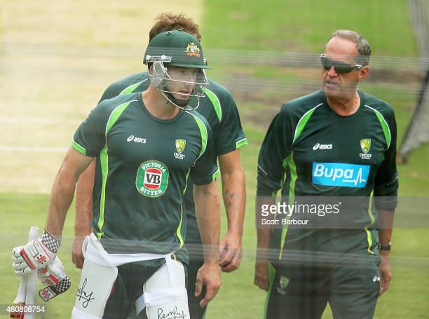 Shaun Marsh of Australia leaves the nets with Australia team doctor Peter Brukner after being hit on the hand during an Australian nets session at...