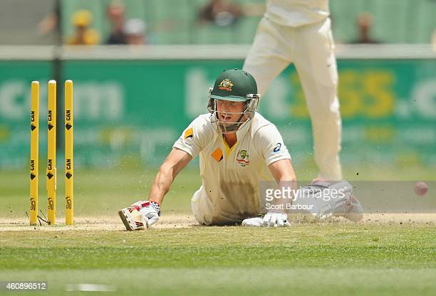 Shaun Marsh of Australia looks on as he is run out out for 99 runs during day five of the Third Test match between Australia and India at Melbourne...