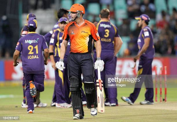Shaun Marsh of Perth Scorchers walks off after being trapped lbw during the Karbonn Smart CLT20 match between Kolkata Knight Riders and Perth...