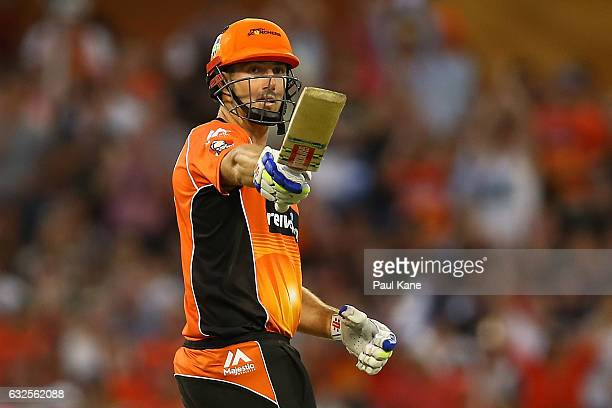 Shaun Marsh of the Scorchers acknowledges the players dug out affter scoring his half century during the Big Bash League match between the Perth...