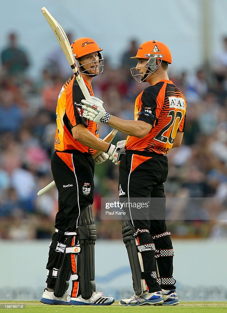 <a gi-track='captionPersonalityLinkClicked' href=/galleries/search?phrase=Shaun+Marsh+-+Cricket+Player&family=editorial&specificpeople=236104 ng-click='$event.stopPropagation()'>Shaun Marsh</a> of the Scorchers celebrates his half century with <a gi-track='captionPersonalityLinkClicked' href=/galleries/search?phrase=Adam+Voges&family=editorial&specificpeople=724770 ng-click='$event.stopPropagation()'>Adam Voges</a> during the Big Bash League match between the Perth Scorchers and the Melbourne Renegads at WACA on December 29, 2012 in Perth, Australia.