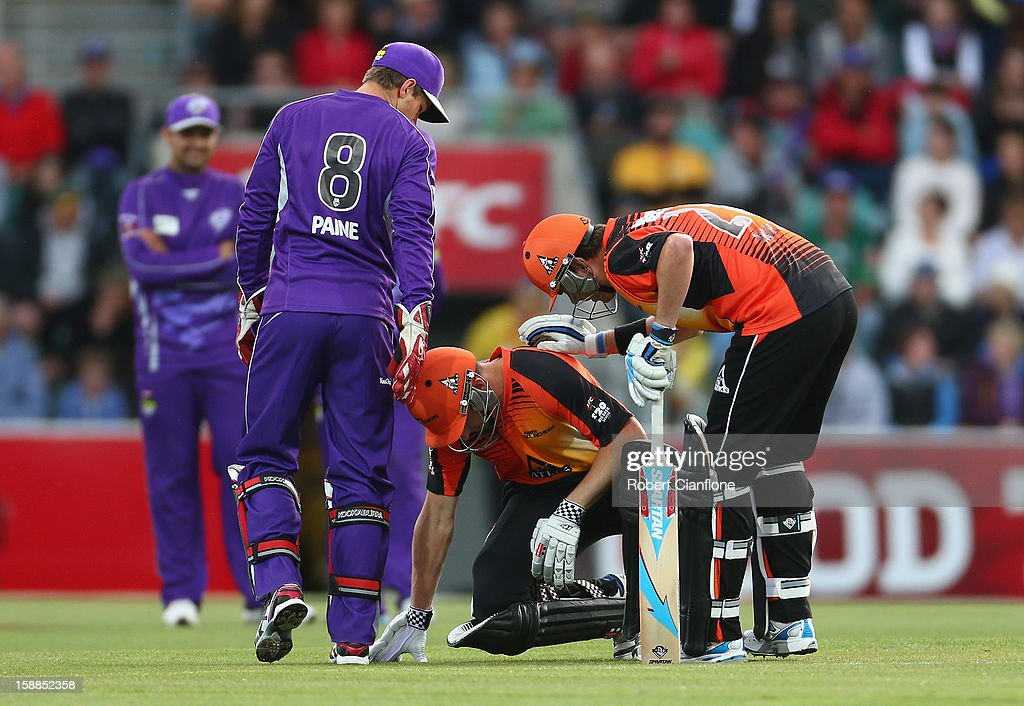 <a gi-track='captionPersonalityLinkClicked' href=/galleries/search?phrase=Shaun+Marsh+-+Cricket+Player&family=editorial&specificpeople=236104 ng-click='$event.stopPropagation()'>Shaun Marsh</a> of the Scorchers is checked on by team mate <a gi-track='captionPersonalityLinkClicked' href=/galleries/search?phrase=Marcus+North&family=editorial&specificpeople=167183 ng-click='$event.stopPropagation()'>Marcus North</a> after he was struck on the hand by a Doug Bollinger delivery during the Big Bash League match between the Hobart Hurricanes and the Perth Scorchers at Blundstone Arena on January 1, 2013 in Hobart, Australia.