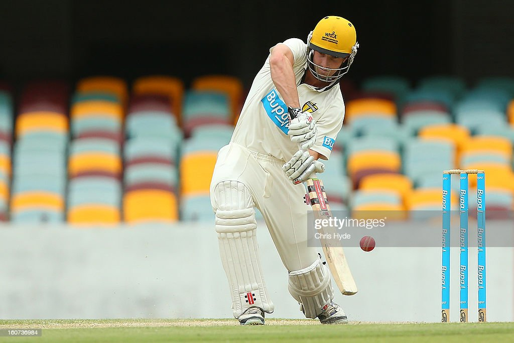 <a gi-track='captionPersonalityLinkClicked' href=/galleries/search?phrase=Shaun+Marsh+-+Cricket+Player&family=editorial&specificpeople=236104 ng-click='$event.stopPropagation()'>Shaun Marsh</a> of the Warriors bats during day two of the Sheffield Shield match between the Queensland Bulls and the Western Australia Warriors at The Gabba on February 5, 2013 in Brisbane, Australia.