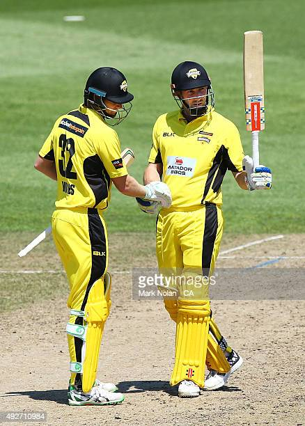 Shaun Marsh of the Warriors celebrates 150 runs with team mate Adam Voges during the Matador BBQs One Day Cup match between Western Australia and...