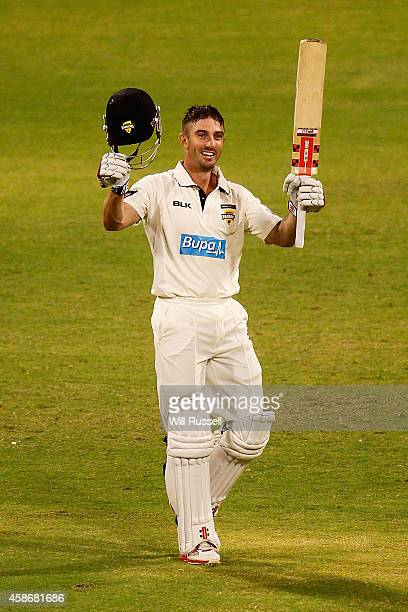 Shaun Marsh of the Warriors celebrates after reaching his century during Day Two of the Sheffield Shield match between Western Australia and...