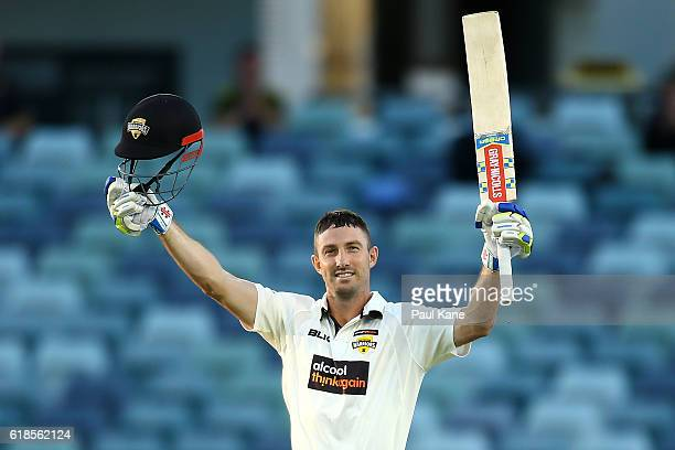 Shaun Marsh of the Warriors celebrates his century during day three of the Sheffield Shield match between Western Australia and South Australia at...