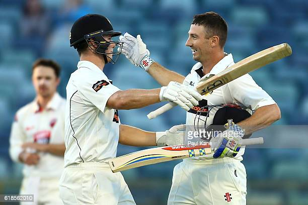 Shaun Marsh of the Warriors celebrates his century with Hilton Cartwright during day three of the Sheffield Shield match between Western Australia...
