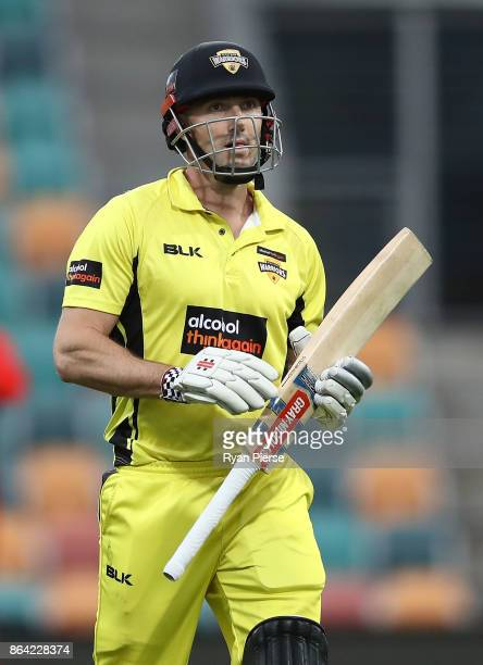 Shaun Marsh of the Warriors looks dejected after being dismissed by Joe Mennie of the Redbacks during the JLT One Day Cup Final match between Western...