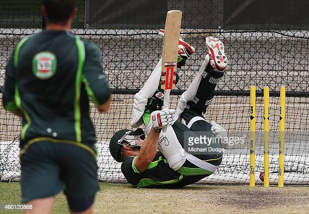 Shaun Marsh tumbles over after nearly getting hit from a bouncer bowled by James Pattinson during an Australian nets session at Adelaide Oval on...