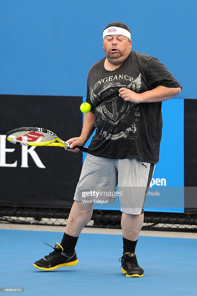 Shaun McDonough, the winner of the Kia 'Game On' app receives a serve from Sam Groth of Australia, who holds the record for the world's fastest serve during day 7 of the 2014 Australian Open at Melbourne Park on January 19, 2014 in Melbourne, Australia.