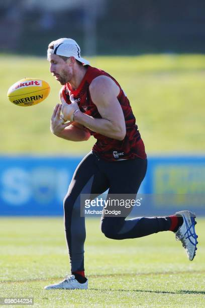 Shaun McKernan of the Bombers fumbles a mark during an Essendon Bombers AFL training session at True Value Centre on June 20 2017 in Melbourne...