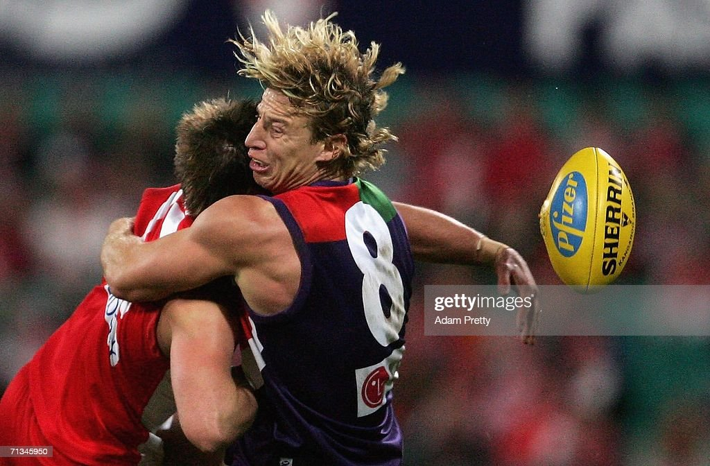 Shaun McManus of the Dockers tackles during the round 13 AFL match between the Sydney Swans and the Fremantle Dockers at the Sydney Cricket Ground...