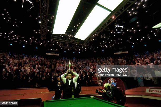 Shaun Murphy celebrates with the Embassy World Championship trophy after winning 18 frames to 16 against Matthew Stevens