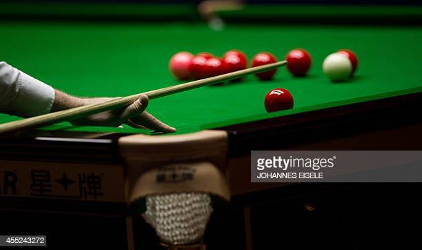 Shaun Murphy of Britain plays a shot against Graeme Dott of Britain during the Snooker Shanghai Masters in Shanghai on September 11 2014 Dott won...