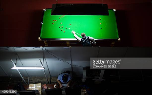Shaun Murphy of Britain plays a shot as he trains during the Snooker Shanghai Masters in Shanghai on September 11 2014 The World Snooker Masters will...
