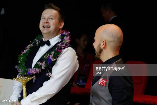 Shaun Murphy of England and Luca Brecel of Belgium attend awarding ceremony after the final match on day seven of Evergrande 2017 World Snooker China...