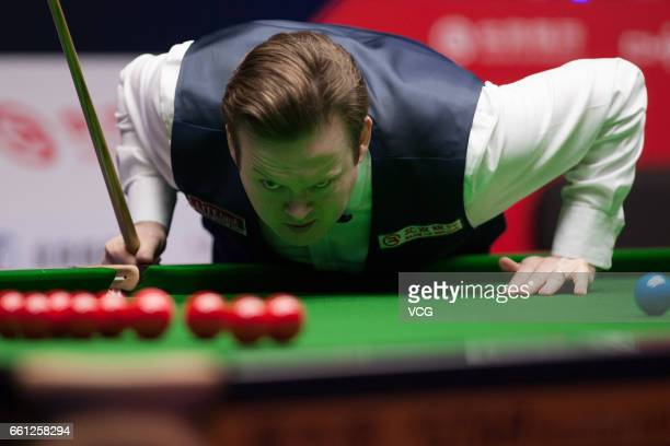 Shaun Murphy of England eyes the ball in the quarterfinal match against Mark Williams of Wales on day five of 2017 China Open at Peking University...