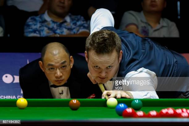 Shaun Murphy of England plays a shot during the final match against Luca Brecel of Belgium on day seven of Evergrande 2017 World Snooker China...