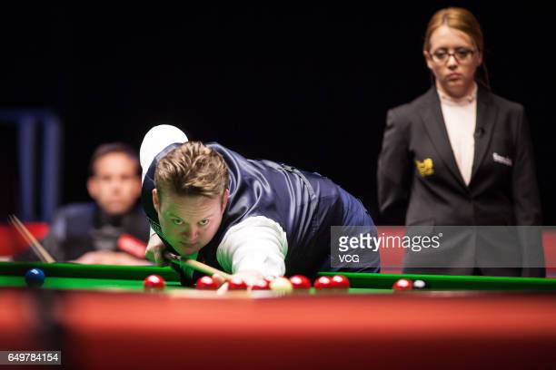 Shaun Murphy of England plays a shot during the first round match against Ali Carter of England on day three of 2017 Ladbrokes Players Championship...
