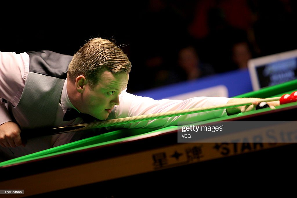 Shaun Murphy of England plays a shot during the match against Marco Fu of Hong Kong on day three of the World Snooker Australia Open at the Bendigo Stadium on July 11, 2013 in Bendigo, Australia.