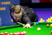 Shaun Murphy of England plays a shot in the final match against Mark Selby of England on day seven of the 2014 Snooker Haikou World Open at Hainan...