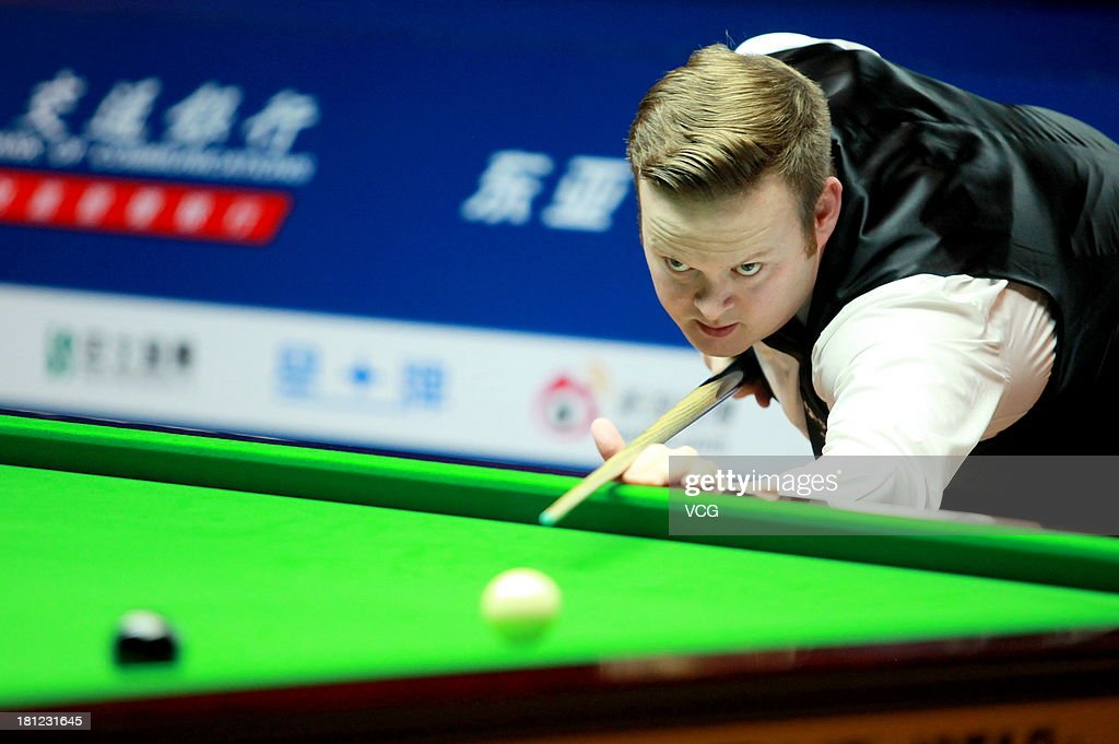 <a gi-track='captionPersonalityLinkClicked' href=/galleries/search?phrase=Shaun+Murphy&family=editorial&specificpeople=208811 ng-click='$event.stopPropagation()'>Shaun Murphy</a> of England plays a shot in the match against Ding Junhui of China on day four of the 2013 World Snooker Shanghai Master at Shanghai Grand Stage on September 19, 2013 in Shanghai, China.