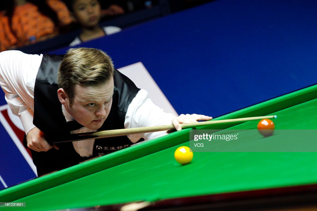Shaun Murphy of England plays a shot in the match against Ding Junhui of China on day four of the 2013 World Snooker Shanghai Master at Shanghai Grand Stage on September 19, 2013 in Shanghai, China.