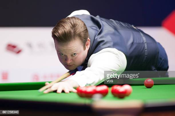 Shaun Murphy of England plays a shot in the quarterfinal match against Mark Williams of Wales on day five of 2017 China Open at Peking University...
