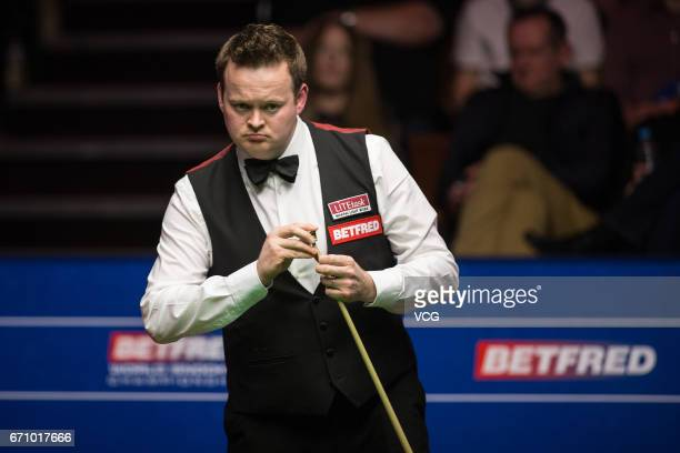 Shaun Murphy of England reacts during his second round match against Ronnie O'Sullivan of England on day six of Betfred World Championship 2017 at...