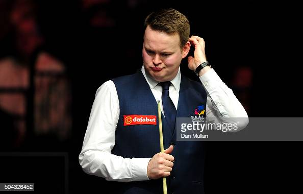 Shaun Murphy of England reacts whilst playing against Mark Allen of Northern Ireland during Day One of the Dafabet Masters at Alexandra Palace on...