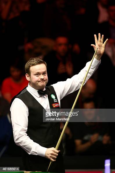 Shaun Murphy of Great Britain celebrates after winning his semifinal match against Mark Allen of Northern Ireland on day seven of the 2015 Dafabet...