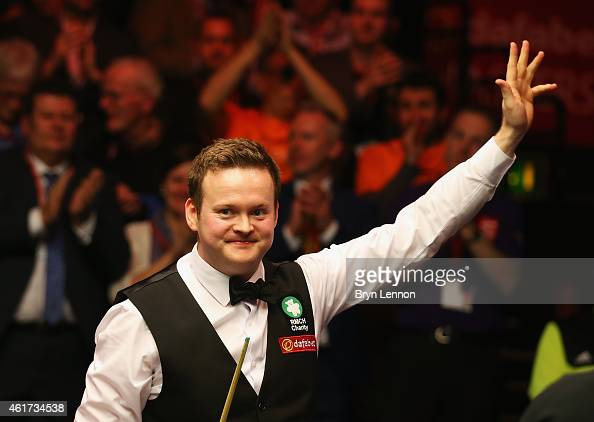 Shaun Murphy of Great Britain celebrates winning the final of the Dafabet Masters at Alexandra Palace on January 18 2015 in London England