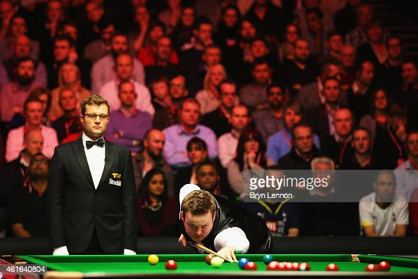Shaun Murphy of Great Britain in action during his quarterfinal match against Stephen Maguire on day six of the Dafabet Masters at Alexandra Palace...