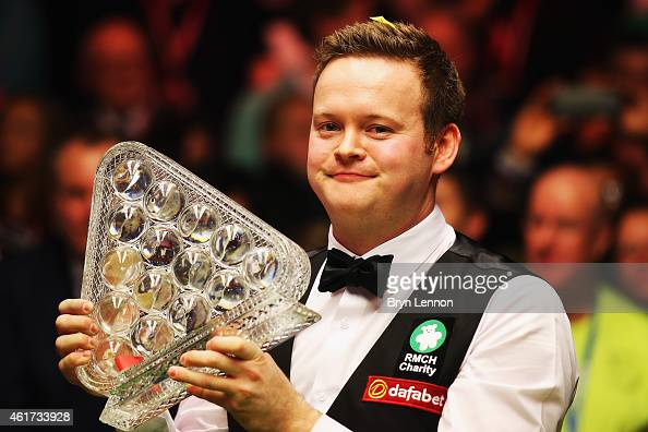 Shaun Murphy of Great Britain lifts the trophy after winning the final of the Dafabet Masters at Alexandra Palace on January 18 2015 in London England