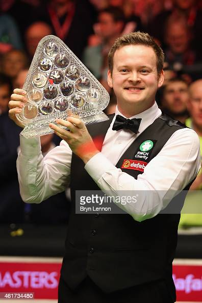 Shaun Murphy of Great Britain poses with the trophy after winning the final of the Dafabet Masters at Alexandra Palace on January 18 2015 in London...