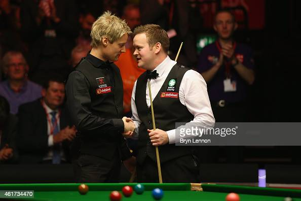 Shaun Murphy of Great Britain shakes hands with Neil Robertson of Australia after winning the final of the Dafabet Masters at Alexandra Palace on...