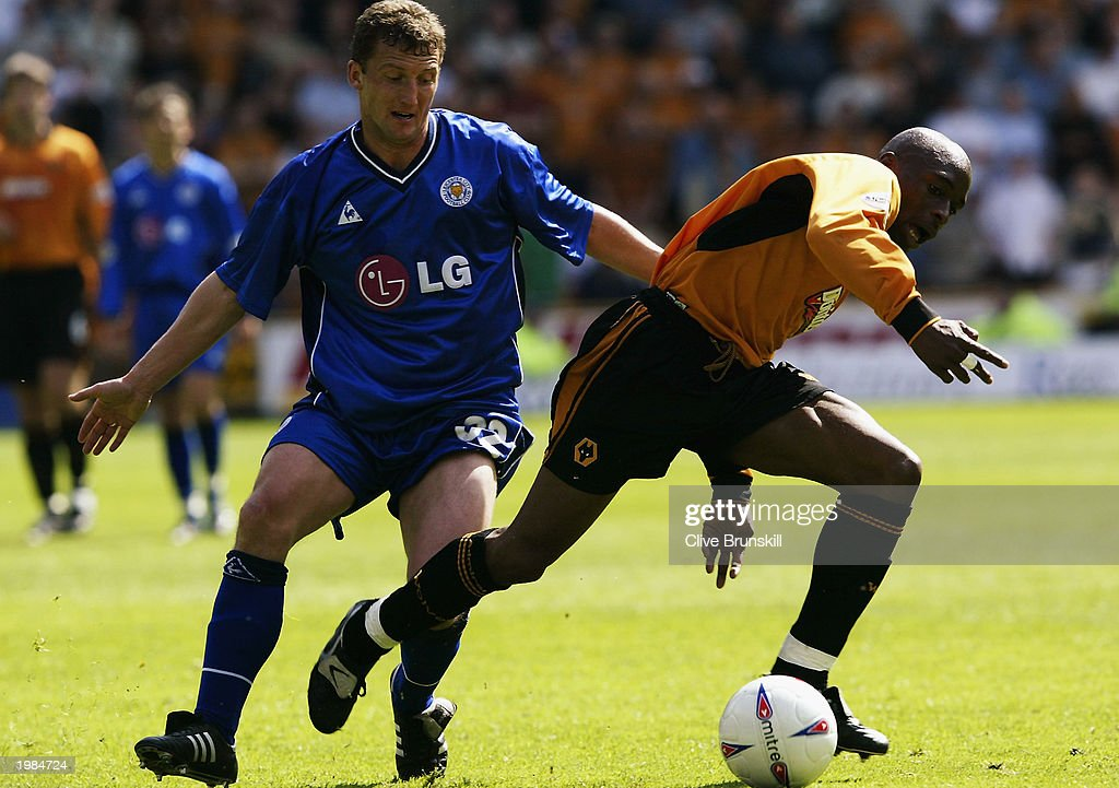 Shaun Newton of Wolverhampton Wanderers is challenged by Billy McKinlay of Leicester City during the Nationwide First Division match between Wolverhampton Wanderers and Leicester City held on May 4, 2003 at the Molineux Stadium in Wolverhampton, England. The match ended in a 1-1 draw.