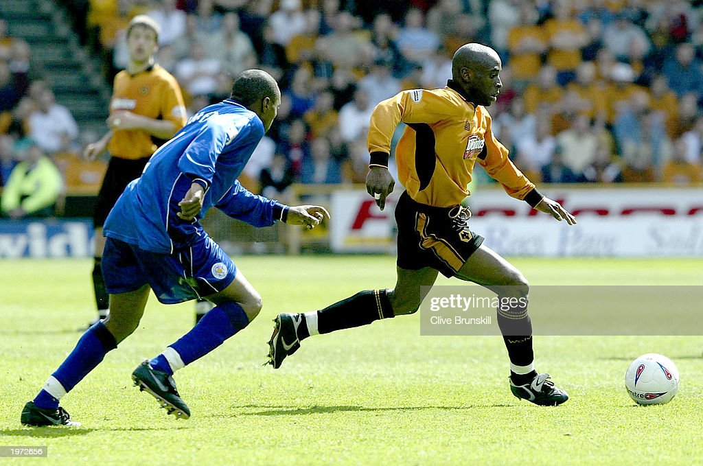 Shaun Newton of Wolves is pursued by Andy Impey of Leicester during the The Nationwide First Division match between Wolverhampton Wanderers and Leicester City on May 4, 2003 at the Molineux Stadium in Wolverhampton, England.