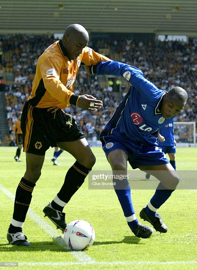 Shaun Newton of Wolves is tackled by Andy Impey of Leicester during the The Nationwide First Division match between Wolverhampton Wanderers and Leicester City on May 4, 2003 at the Molineux Stadium in Wolverhampton, England.