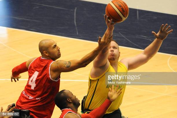 Shaun Norris of Australia and Ghazian Choudhry Great Britain compete for the ball during the Wheelchair Basketball World Challenge Cup final between...