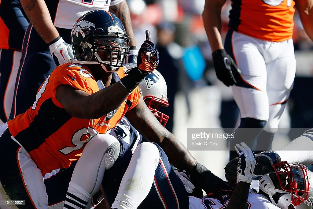 Shaun Phillips #90 of the Denver Broncos reacts to a defensive stop on LeGarrette Blount #29 of the New England Patriots during the AFC Championship game at Sports Authority Field at Mile High on January 19, 2014 in Denver, Colorado.