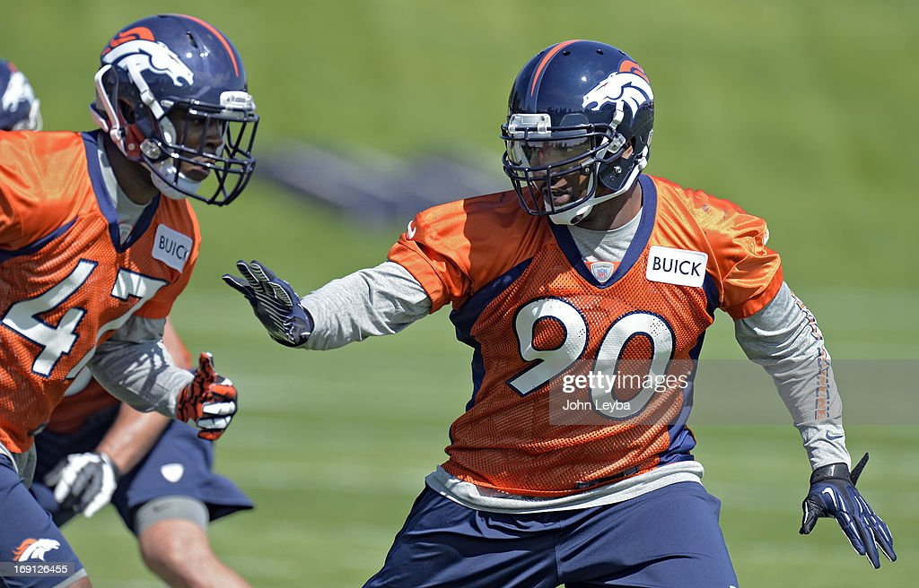 ENGLEWOOD, CO. - Shaun Phillips (90) of the Denver Broncos runs through drills with Lerentee McCray (47) during the teams OTAs May 20, 2013 at Dove Valley. All offseason training activities (OTAs) are voluntary until the mandatory minicamp June 11-13.