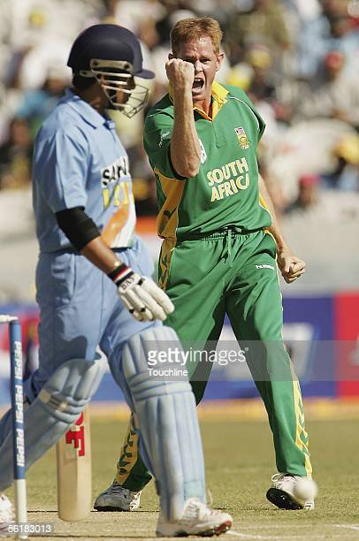 Shaun Pollock of South Africa celebrates the wicket of Sachin Tendulkar for 2 runs during the First One day International match between India and...