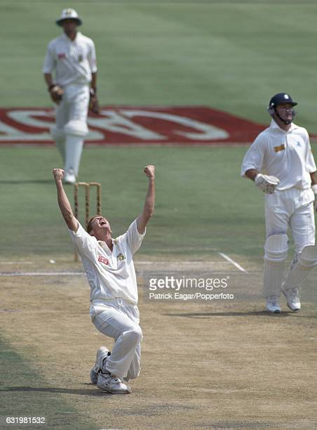 Shaun Pollock of South Africa celebrates trapping England batsman Graeme Hick LBW for 141 in the 1st Test match between South Africa and England at...
