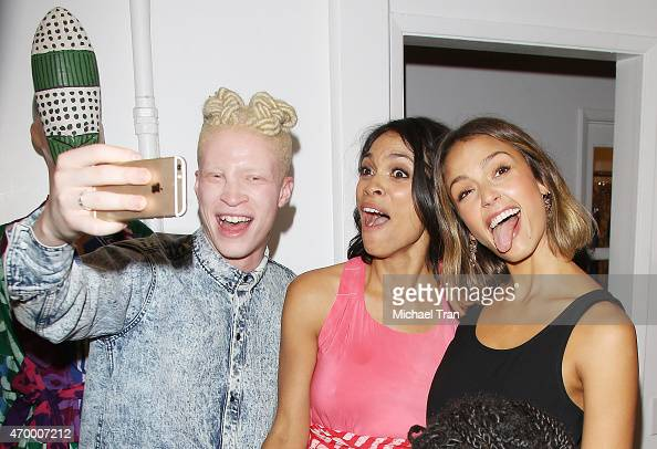 Shaun Ross Rosario Dawson and Jessica Alba take selfies at the launch of Studio One Eighty Nine a clothing line by Rosario Dawson and Abrima Erwiah...