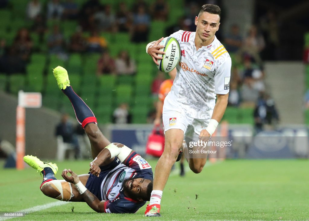 Shaun Stevenson of the Chiefs beats the tackle of Marika Koroibete of the Rebels and runs in to score the final try of the match during the round four Super Rugby match between the Rebels and the Chiefs at AAMI Park on March 17, 2017 in Melbourne, Australia.