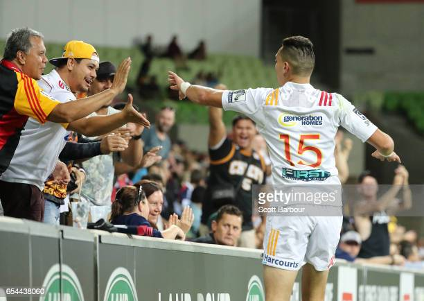 Shaun Stevenson of the Chiefs celebrates with supporters in the crowd after scoring a try which was later disallowed during the round four Super...
