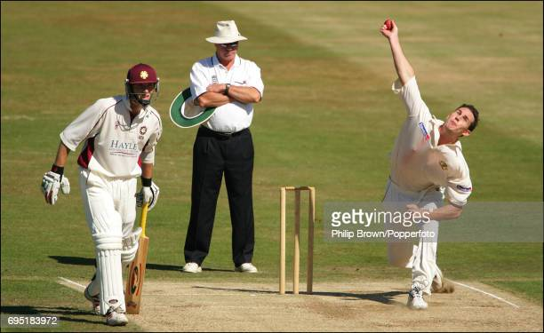 Shaun Tait of Australia bowling against Northamptonshire as Riki Wessels of Northamptonshire looks on at the County Ground in Northampton on the 21st...